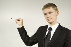 Handsome guy shows his hand. In the direction against Royalty Free Stock Images
