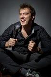 Handsome guy singing Stock Image