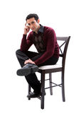 Handsome guy sitting on chair Stock Photography