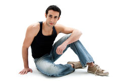 Handsome guy sitting on floor Royalty Free Stock Photos