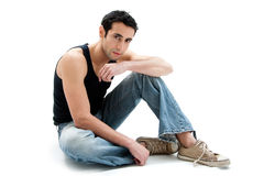 Handsome guy sitting on floor Stock Photography