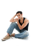 Handsome guy sitting on floor Royalty Free Stock Image
