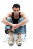 Handsome guy sitting on floor Stock Images