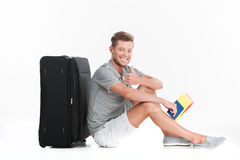 Handsome guy sitting on floor and smiling. Stock Photography