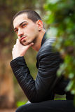 Handsome guy sitting thinking. Short hair Stock Images