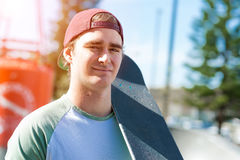 Handsome guy with skateboard Royalty Free Stock Photography