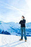 Handsome guy smiling in the Alps Stock Photography