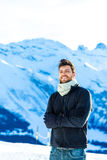 Handsome guy smiling in the Alps Stock Image