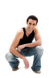 Handsome guy squatting Stock Photography