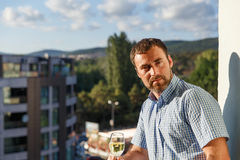 Handsome guy standing on balcony Royalty Free Stock Image