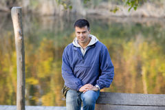 Handsome guy standing next to river Stock Images
