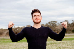Handsome guy with strong arms Royalty Free Stock Photo