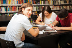 Handsome guy studying in college Royalty Free Stock Photos