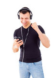 Handsome guy succeeds to run playlist on mobile phone Royalty Free Stock Photos