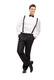Handsome guy with suspenders and bow-tie Royalty Free Stock Images