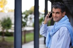 Handsome Guy Talking on Cell Phone Royalty Free Stock Photography