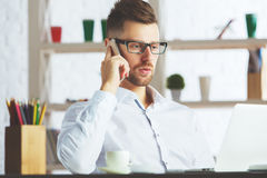 Handsome guy talking on phone Stock Images