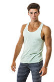 Handsome guy in tank top and leggings on white background . Stylish hair Royalty Free Stock Photos
