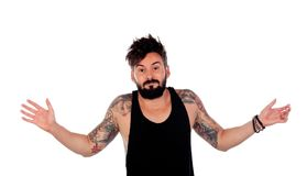 Handsome guy with tattoos apologizing. Isolated on a white background Royalty Free Stock Photo