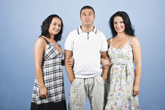 Handsome guy with two models woman stock images