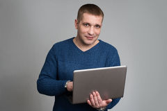Handsome guy using laptop computer Stock Image