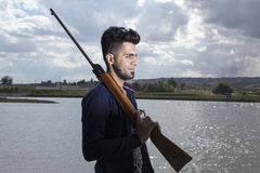 Handsome guy using Pistol Stock Images