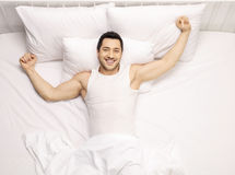 Handsome guy waking up Royalty Free Stock Photography