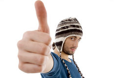 Handsome guy wearing woolen cap with thumbs up Royalty Free Stock Photo