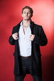 Handsome guy in a white coat Royalty Free Stock Image