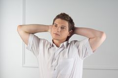 Handsome guy in white shirt Stock Images