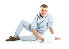 Handsome guy working on a laptop Stock Photo