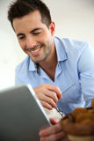 Handsome guy working on touchpad Royalty Free Stock Photos