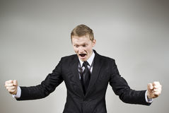 Handsome guy yells happily surprised. At the background Royalty Free Stock Photos