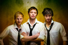 Handsome guys. Three young handsome guys indoors royalty free stock images
