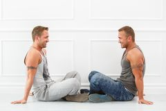 Handsome guys at home Stock Images