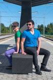 Handsome guys sitting on platform Royalty Free Stock Photography