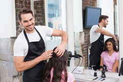 Handsome hair stylist with client Royalty Free Stock Photo