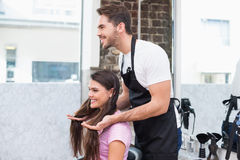 Handsome hair stylist with client Stock Photo
