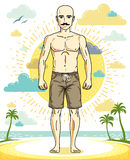 Handsome hairless young man with mustaches standing on tropical Stock Images