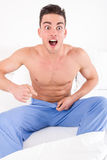 Handsome half naked man having problems with genitals and potenc Royalty Free Stock Images