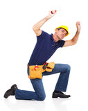 Handyman looking underneath Royalty Free Stock Images