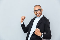 Handsome happy african american young man celebrating success Stock Images