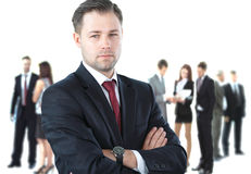 Handsome happy business man with colleagues. At the back Royalty Free Stock Photo