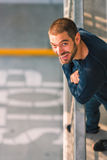 Handsome happy and casual young man standing near balcony Royalty Free Stock Image