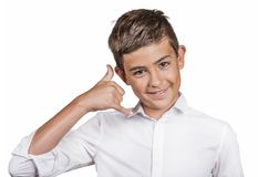 Handsome happy guy, teenager making call me gesture sign with hand Royalty Free Stock Photos