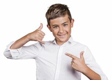 Handsome happy guy, teenager making call me gesture sign with hand Stock Photography