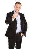Handsome happy isolated young businessman raising up his finger Stock Photos