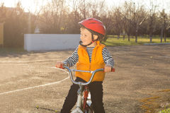 Handsome happy little boy out riding Stock Images