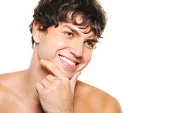 Handsome happy man with clean-shaven face. Portrait of handsome young man with clean-shaven face and happy smile Royalty Free Stock Images