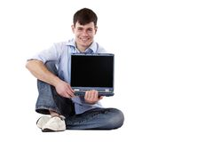 Handsome, happy man holding computer monitor Stock Photo